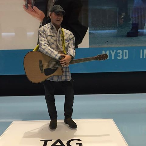 3d printed statue by my3d agency holding guitar